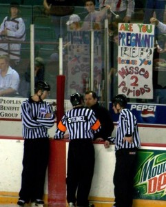 "Talking to the Refs, an old hockey tradition. No idea who sent this phtoto to me, but it's too funny to ignore. My friend Bob Lemieux is penning his hockey memoirs right now -- under the title of Off Wing -- and this photograph reminds me of the ""good old days in the Eye (the IHL)."
