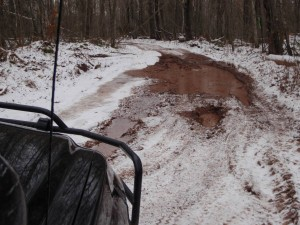 Conservation officers drive a lot of rough roads and rarely even pause to contemplate impediments, but this one gave us cause to measure how deep it was.