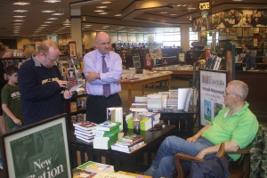 Barnes & Noble book-signing, Saginaw. Photo by Tom Kochendorfer, who obviiously forgot to photo-shopt the spare tire off the sitting author....