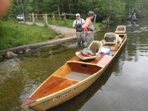 AuSable River boat, all 22 feet of it, based on Native American dugouts. History says this sort of boat originated in the Adorondacks and was brought to Michigan by loggers. It drafts only 3 inches of water.