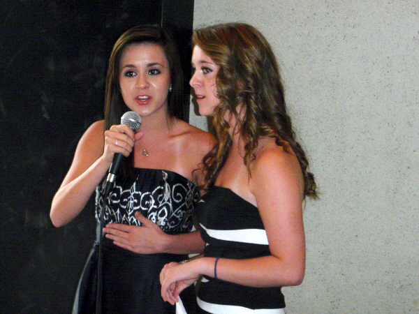 Meet Megan and Liz, two young women with huge talent and modest about it. You can link to some of their work on this website. Here they are singing at their cousin's wedding, having just returned from a big gig in Cincinatti. They write some of their own stuff, have a large and growing following and work like dogs, as most artists do.