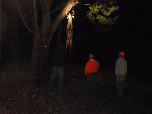 Checking deer camps at night.
