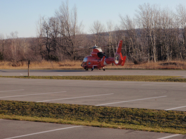 While search teams make their way to the victim on foot, the Coastie chopper sits in the lot conserving fuel.