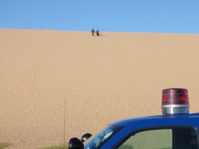 The K-9 team tops the dune returning to the vehicles.