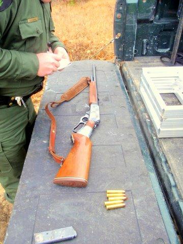 Loaded gun in vehicle.