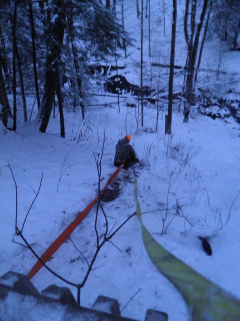 CO Mike Wells rapelling down to deer carcasses.