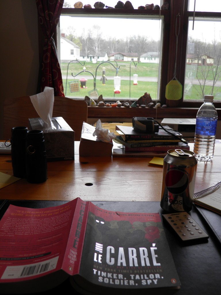 "View from the writer-reader's ""desk"" (also called the dining room table). Yes I'm rereading John LeCarre's ouvre this summer."